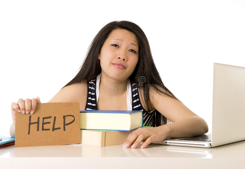 Young pretty chinese girl with help sign working stock image