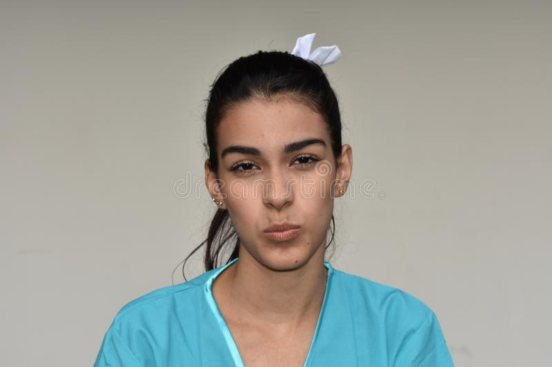 Confused Young Female Nurse. A young pretty Colombian teenage girl royalty free stock photo