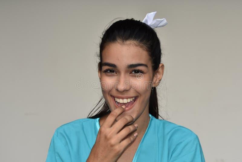 Happy Hispanic Female Nurse. A young pretty Colombian teenage girl royalty free stock photos