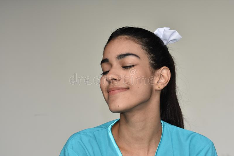 Pretty Female Nurse Wondering. A young pretty Colombian teenage girl royalty free stock photography