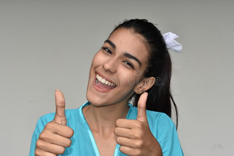 Successful Pretty Female Nurse. A young pretty Colombian teenage girl royalty free stock photo