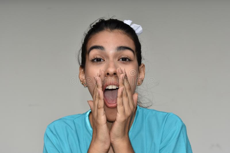 Surprised Young Colombian Female Nurse. A young pretty Colombian teenage girl stock images