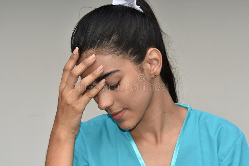 Tired Female Nurse. A young pretty Colombian teenage girl stock photos