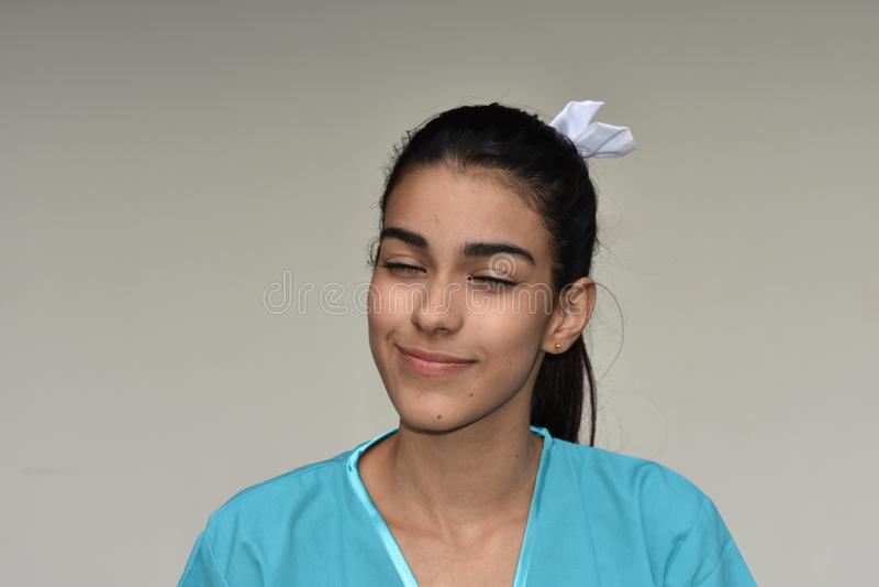 Wondering Hispanic Female Nurse. A young pretty Colombian teenage girl stock photos