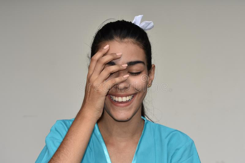 Young Colombian Female Nurse Laughing. A young pretty Colombian teenage girl stock photos