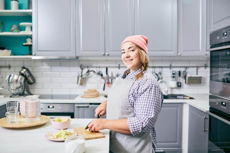 Cheerful woman cooking stock photography
