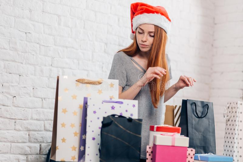 Young pretty ginger girl preparing for New Year royalty free stock photo