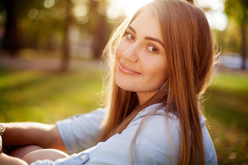 Young pretty girl in autumn park, close-up royalty free stock photo