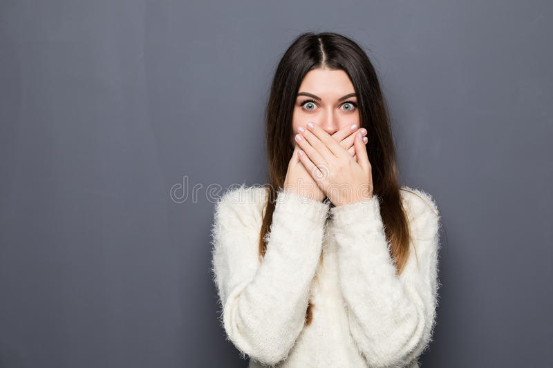 Young pretty girl covering her mouth royalty free stock image