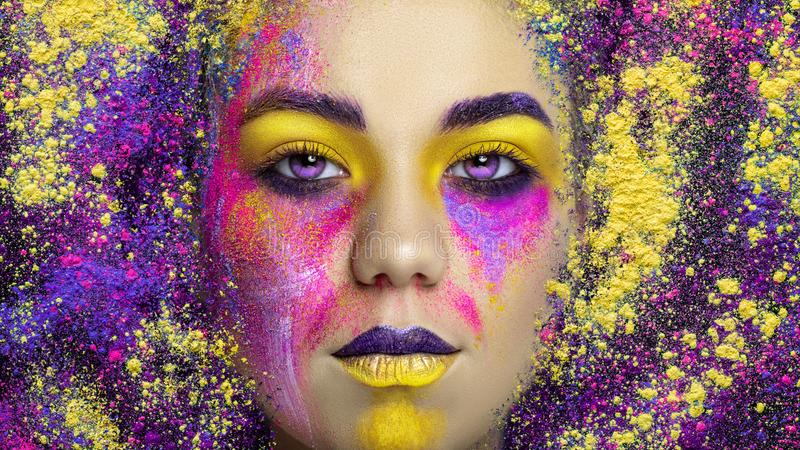 Young pretty girl with creative make-up, studio shoot. Young pretty girl with colorful creative make-up, studio shoot stock photography