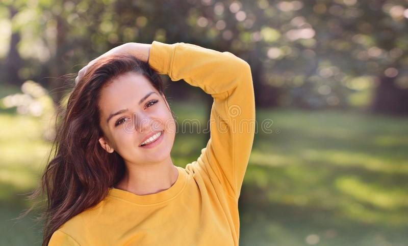 Young pretty girl in the park royalty free stock photos