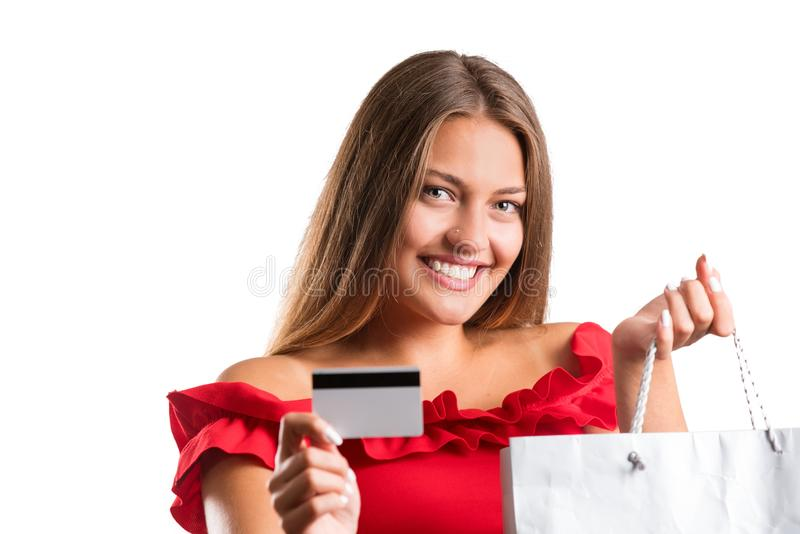 Young pretty girl in red dress holding presents. isolated royalty free stock images