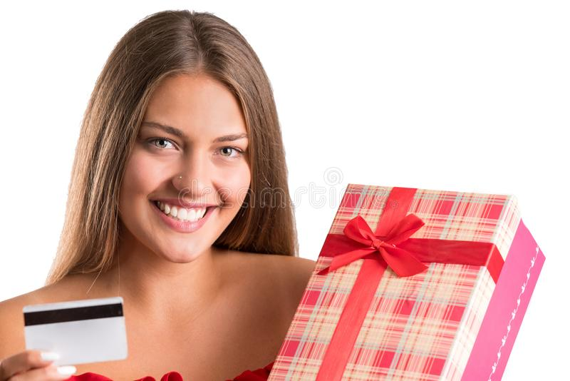 Young pretty girl in red dress holding presents. isolated stock photography