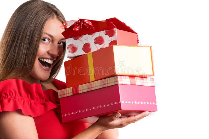 Young pretty girl in red dress holding presents. isolated stock photo
