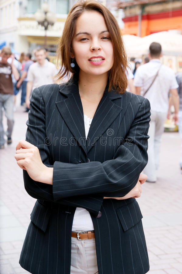 Young pretty girl in the street stock image
