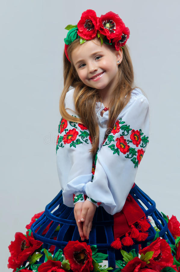 Young pretty girl in a ukrainian national costume. On a light background stock photography