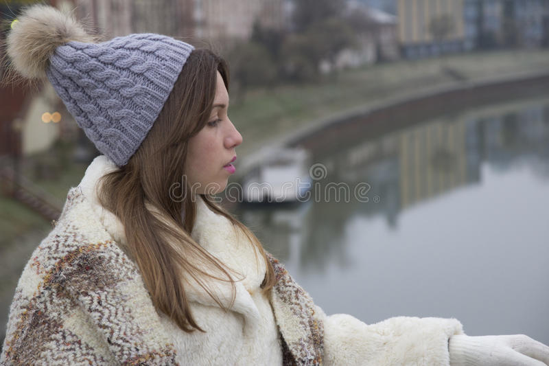 A young pretty girl walks royalty free stock photography