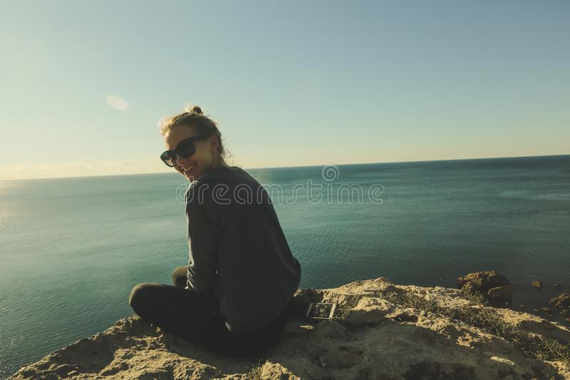 Warm sunny portrait of young happy woman royalty free stock photo