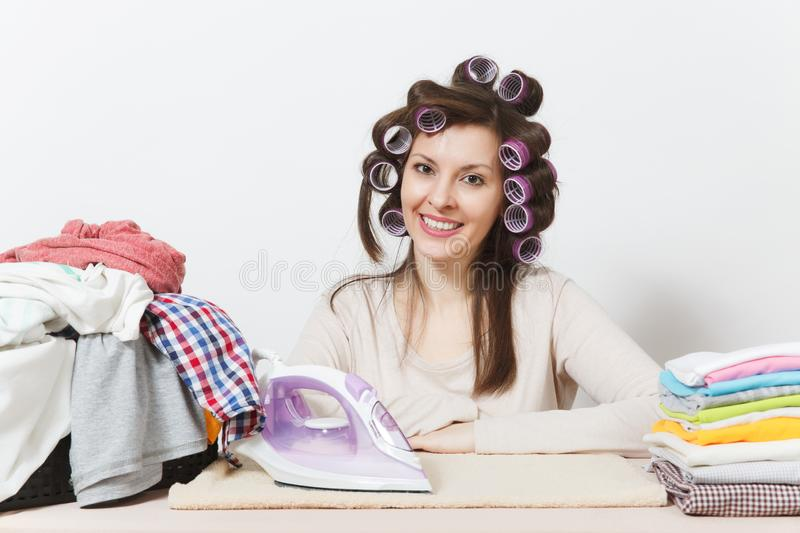 Young pretty housewife. Woman on white background. Housekeeping concept. Copy space for advertisement. royalty free stock images