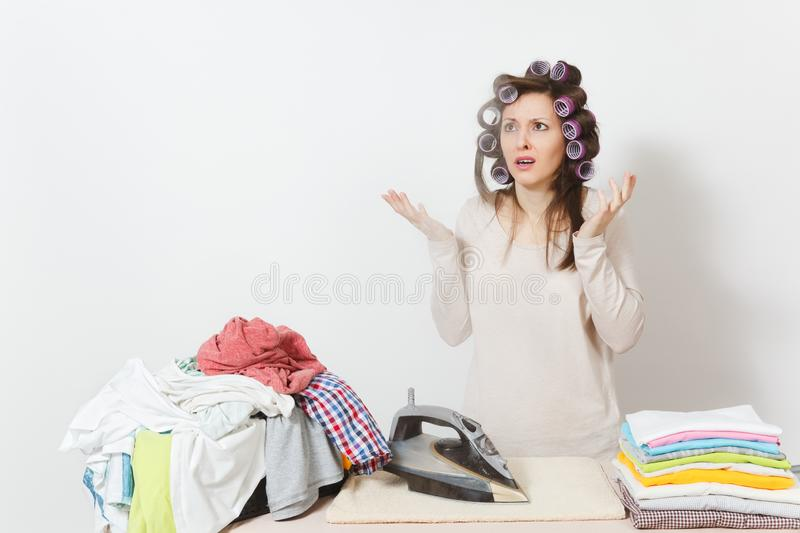 Young pretty housewife. Woman on white background. Housekeeping concept. Copy space for advertisement. stock photo
