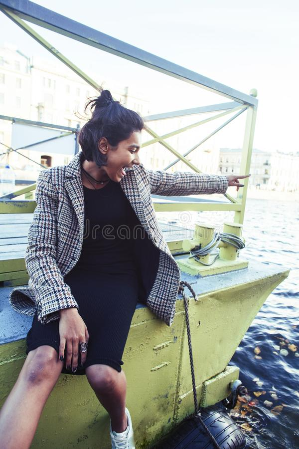 Young pretty indian girl posing cheerful at pier in city, lifestyle people concept. Closeup royalty free stock photo