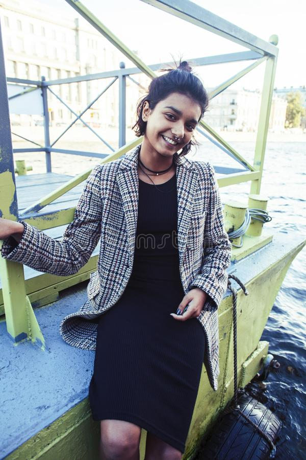 Young pretty indian girl posing cheerful at pier in city, lifestyle people concept. Closeup royalty free stock photography