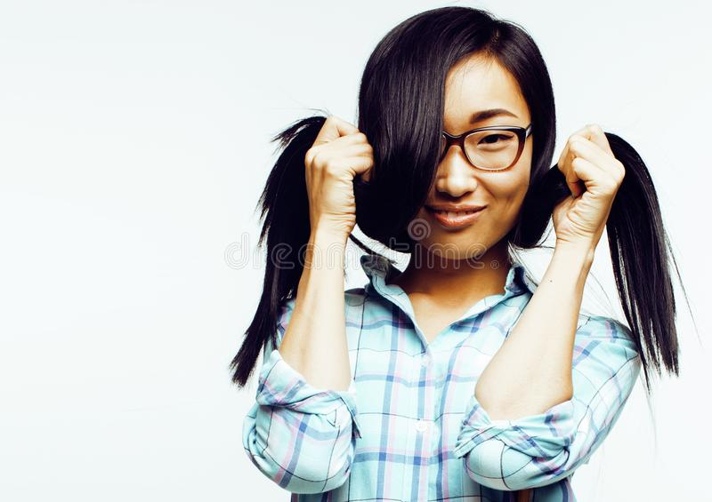 Young pretty long hair asian woman happy smiling emotional posin. G on white background, lifestyle people concept close up royalty free stock photo