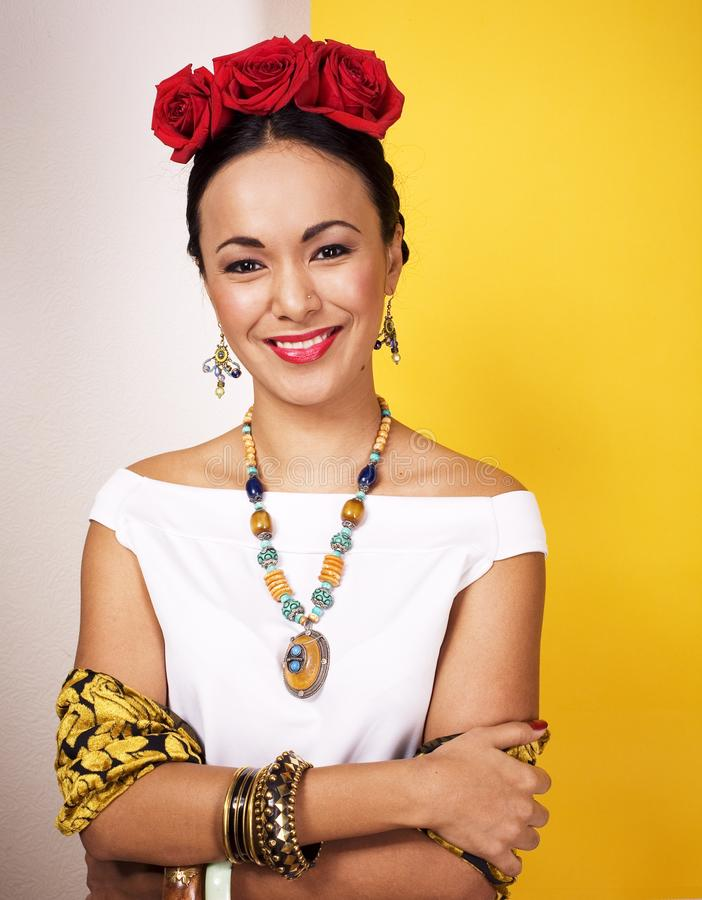 Young pretty mexican woman smiling happy on yellow background, l royalty free stock images