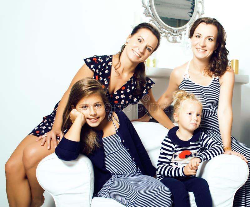 Young pretty modern family at home happy smiling, lifestyle people concept, mother with cute little daughter, sister stock photo