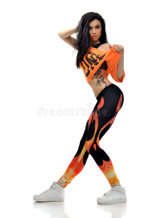 Young pretty modern slim hip-hop style teenage girl dancer with royalty free stock photo