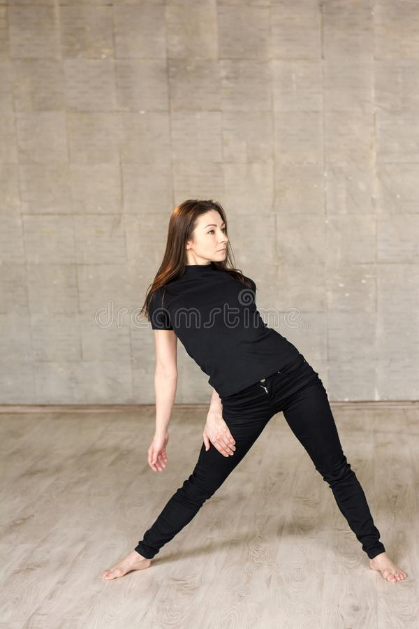 Young pretty modern style dancer. royalty free stock photography