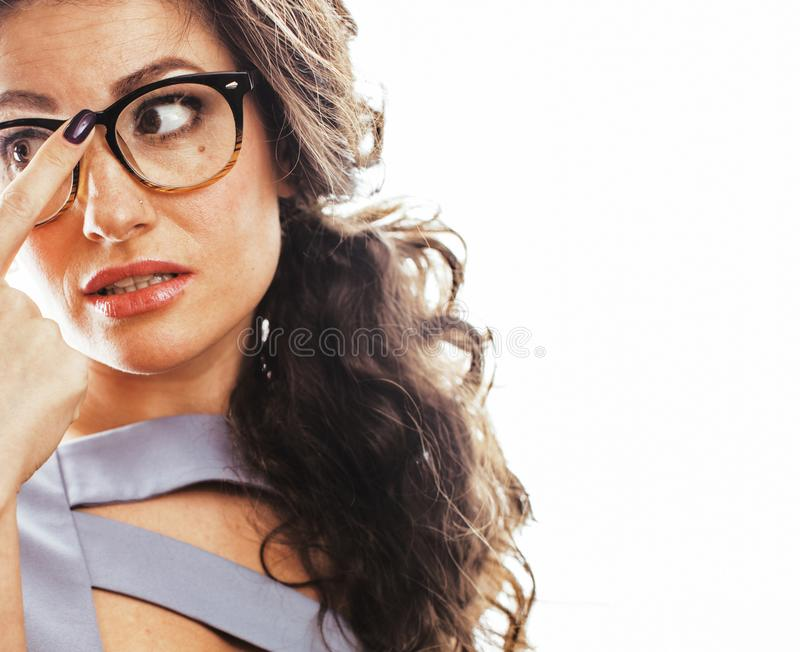 Young pretty real brunette woman secretary in dress wearing glasses isolated on white background pointing gesturing. Emotional cheerful lady close up royalty free stock photography