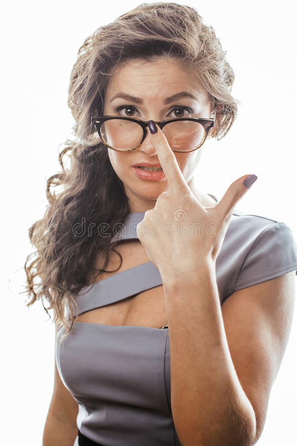 Young pretty real brunette woman secretary in dress wearing glasses isolated on white background pointing gesturing. Emotional cheerful lady, businesswoman royalty free stock image