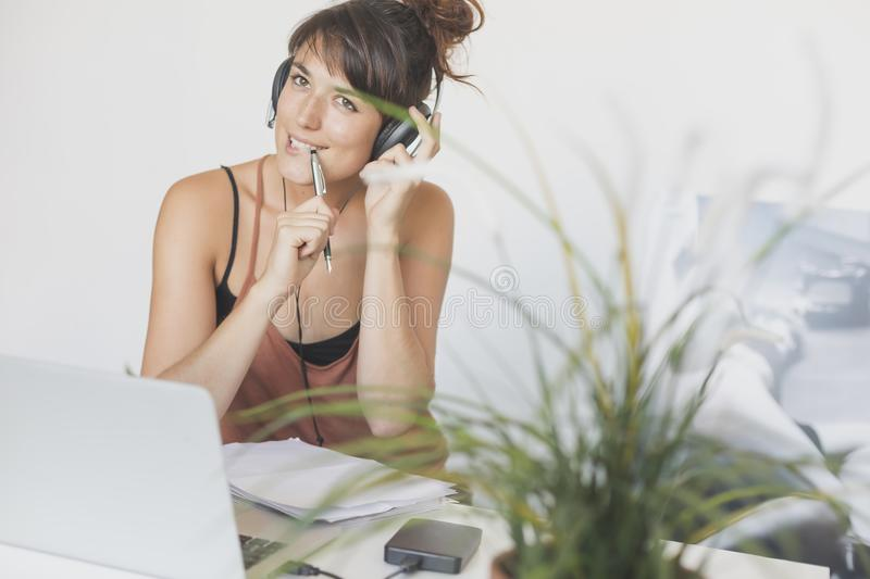 Young and pretty startup worker working at home royalty free stock photography