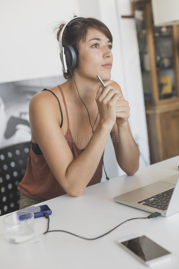 Young and pretty startup worker working at home stock images