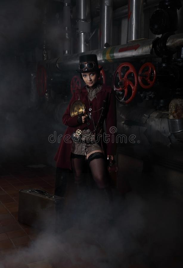 Young pretty steampunk girl with suitcase stock photography