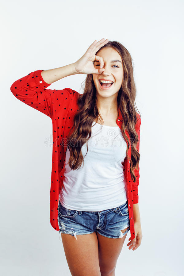 Young pretty stylish hipster girl posing emotional isolated on white background happy smiling cool smile, lifestyle stock photo
