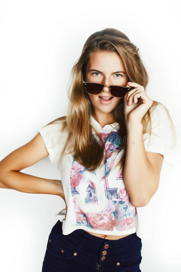 Young pretty teen blond girl posing cheerful isolated on white background wearing sunglasses, lifestyle people concept. Closeup royalty free stock images