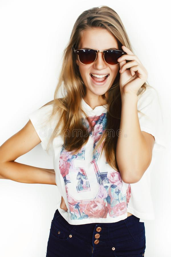 Young pretty teen blond girl posing cheerful isolated on white background wearing sunglasses, lifestyle people concept. Closeup stock photography