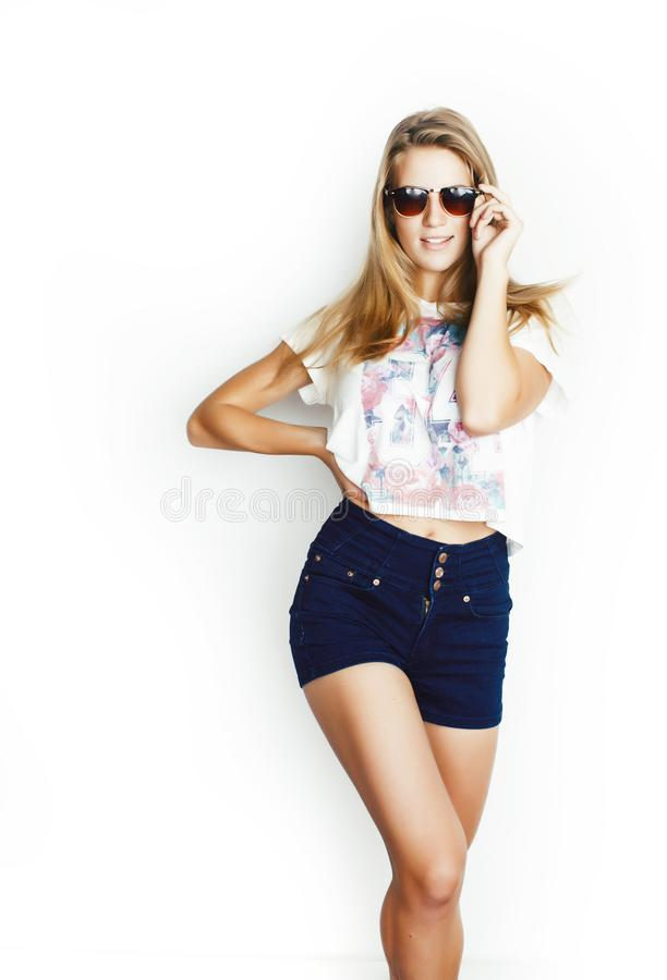 Young pretty teen blond girl posing cheerful isolated on white background wearing sunglasses, lifestyle people concept. Closeup stock images