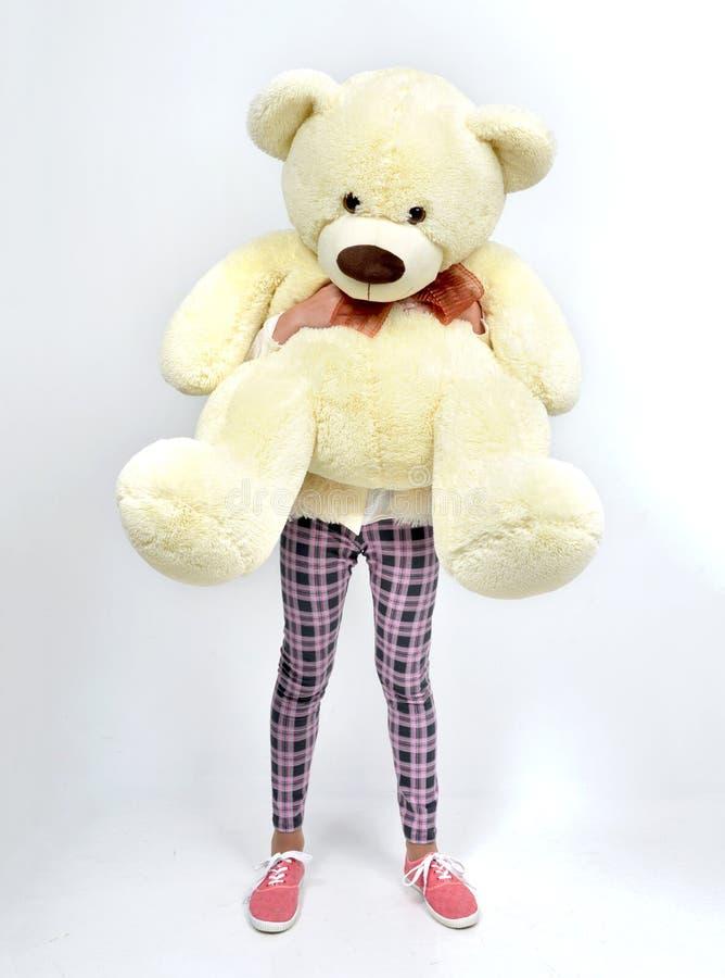 Young pretty teenage girl happy hugging big teddy bear instead o stock photos