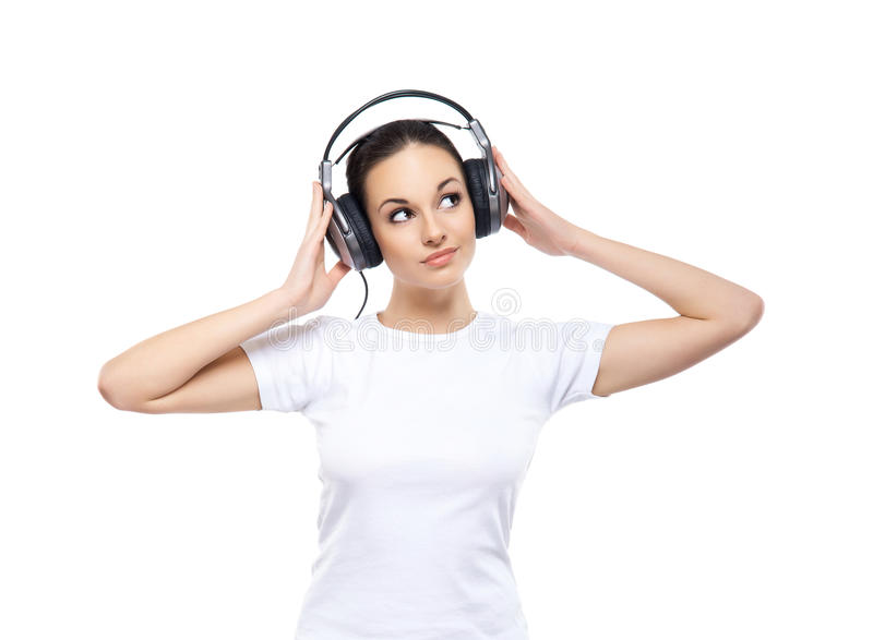 Young and pretty teenage girl listening to the music stock photo