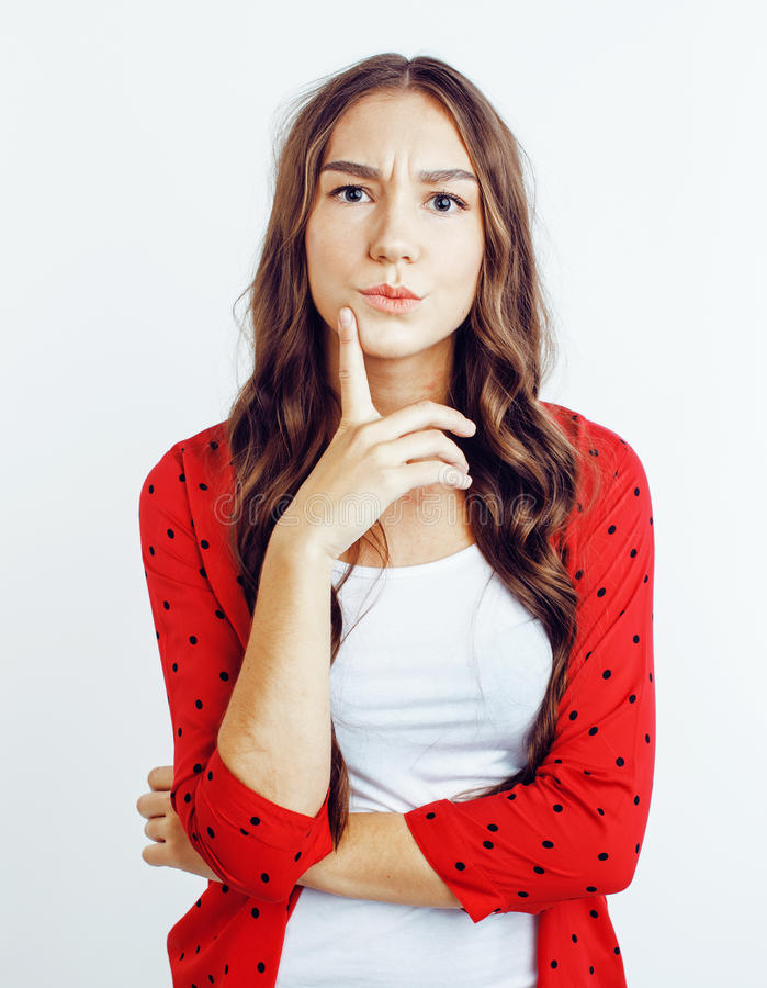 Young pretty teenage hipster girl posing emotional happy smiling on white background, lifestyle people concept. Close up royalty free stock photo