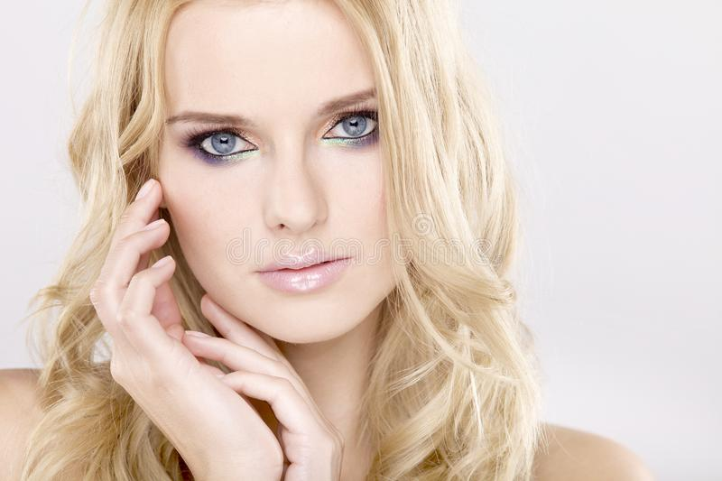 Young pretty woman with beautiful blond hairs royalty free stock photos