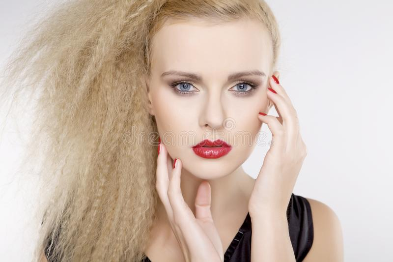 Young pretty woman with beautiful blond hairs royalty free stock photo