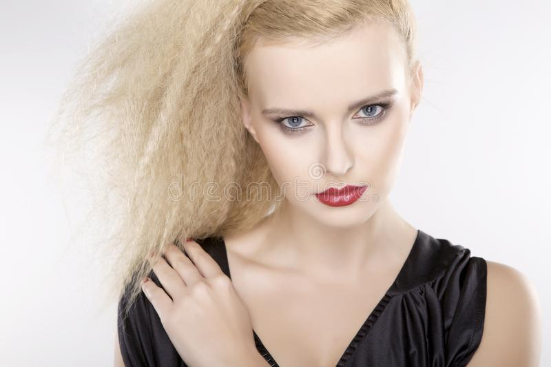 Young pretty woman with beautiful blond hairs royalty free stock image