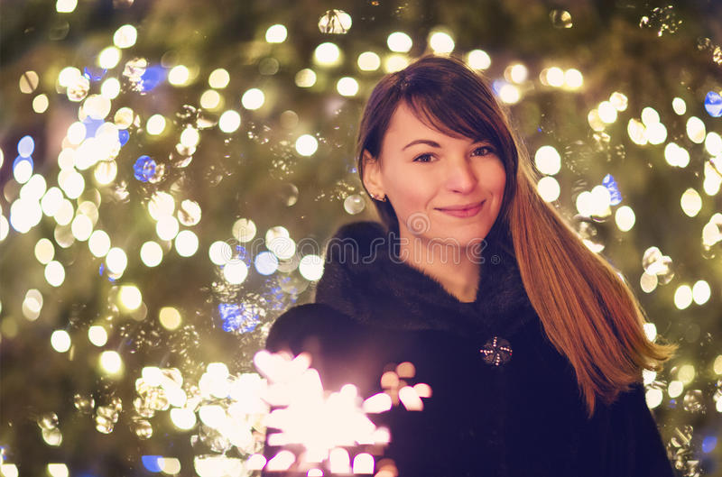 Young pretty woman with Bengal light looking at camera stock images