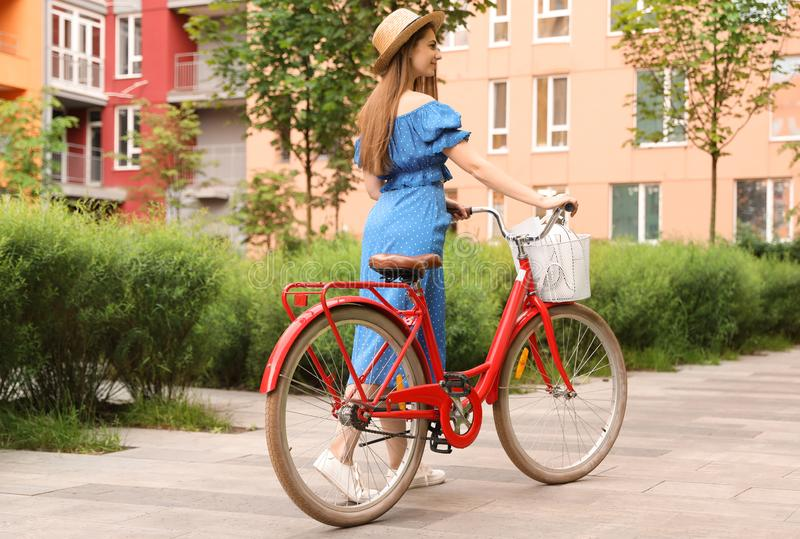 Young pretty woman with bicycle stock images