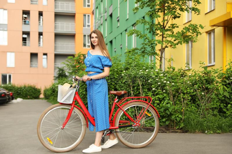 Young pretty woman with bicycle royalty free stock photo