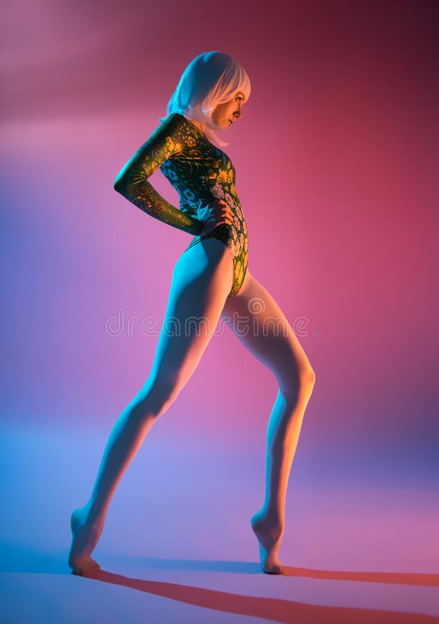 Young pretty woman in bodysuit stock photography